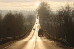 Por do sol do brilho Imagens de Stock
