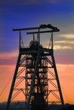 Por do sol do eixo de mina Imagens de Stock