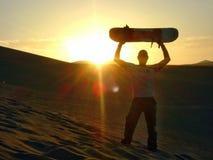Por do sol do embarque da areia Fotografia de Stock