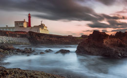 Por do sol do farol Fotos de Stock Royalty Free