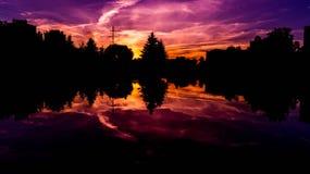 Por do sol do fogo Foto de Stock