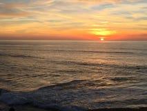 Por do sol do fulgor alaranjado Fotografia de Stock Royalty Free