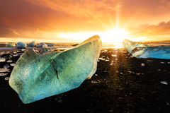 Por do sol do gelo da praia Fotografia de Stock Royalty Free