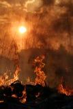 Por do sol do inferno Imagens de Stock