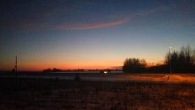 Por do sol do inverno na estrada Fotografia de Stock