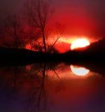 Por do sol do lago Imagens de Stock