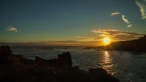 Por do sol do lapso de tempo do litoral filme