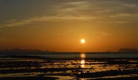 Por do sol do mar Imagens de Stock