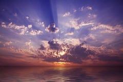 Por do sol do mar Imagem de Stock