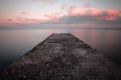 Por do sol do mar calmo Imagens de Stock Royalty Free