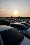 Por do sol do parque de estacionamento Foto de Stock