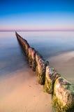 Por do sol do quebra-mar Imagem de Stock