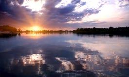 Por do sol do rio Imagem de Stock