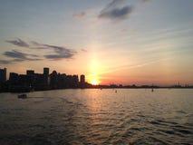 Por do sol do verão de Boston do porto Imagens de Stock