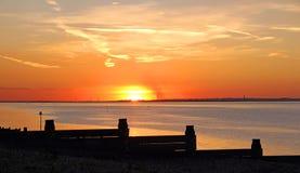 Por do sol dourado de Whitstable fotografia de stock royalty free