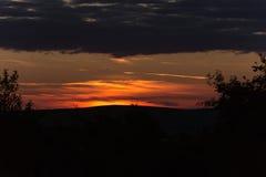 Por do sol dourado surpreendente Foto de Stock