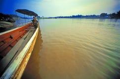 Por do sol e barco velho Fotografia de Stock Royalty Free