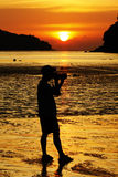 Por do sol e fotógrafo Fotos de Stock Royalty Free