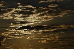Por do sol e fundos das nuvens Imagens de Stock