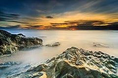 Por do sol e nascer do sol Foto de Stock