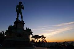 Por do sol e o David Imagens de Stock