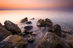 Por do sol e o mar Imagens de Stock Royalty Free