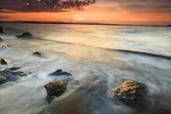 Por do sol e oceano Imagem de Stock