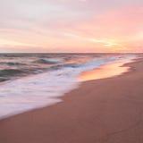 Por do sol e praia imagem de stock royalty free