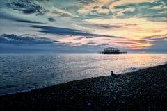Por do sol em Brighton Beach Fotos de Stock Royalty Free