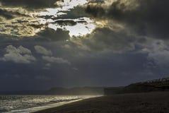 Por do sol em Devon Jurassic Coast imagem de stock