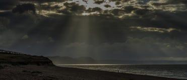 Por do sol em Devon Jurassic Coast fotos de stock royalty free