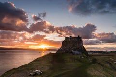 Por do sol em Lindisfarne Foto de Stock