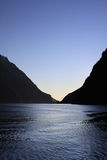 Por do sol em Milford Sound Foto de Stock Royalty Free