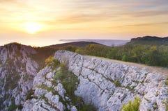 Por do sol em montanhas da altura Imagens de Stock