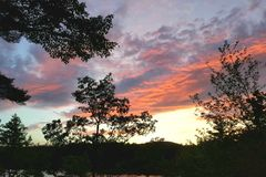 Por do sol em New Hampshire imagem de stock