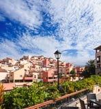 Por do sol em Puerto de la Cruz, Tenerife, Spain. Recurso do hotel do turista. Por do sol Fotografia de Stock