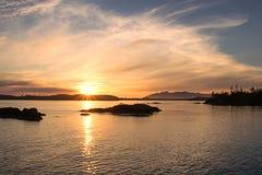 Por do sol em uma entrada na costa oeste Foto de Stock