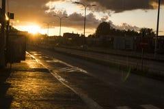 Por do sol em uma parada do ônibus Imagem de Stock