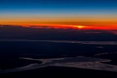 Por do sol em voo Imagens de Stock Royalty Free