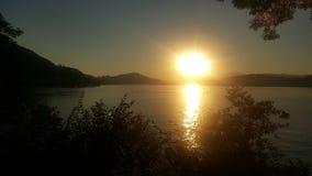 Por do sol em Woerthersee em Áustria Fotografia de Stock