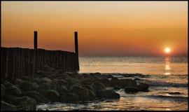 Por do sol em Zeeland, os Países Baixos fotos de stock