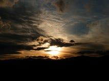 Por do sol escuro Imagem de Stock Royalty Free