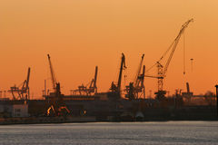Por do sol industrial Imagens de Stock