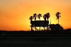 Por do sol litoral Imagem de Stock