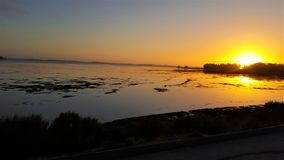 Por do sol litoral foto de stock