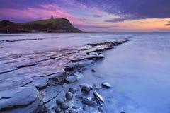 Por do sol na baía de Kimmeridge em Inglaterra do sul fotografia de stock