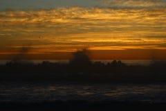Por do sol na costa Fotos de Stock Royalty Free