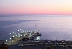 Por do sol na costa de mar Alanya, Turquia Imagem de Stock Royalty Free