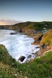Por do sol na costa de Trebarwith Foto de Stock Royalty Free