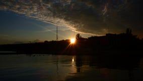 Por do sol na costa do mar de Azov Fotos de Stock